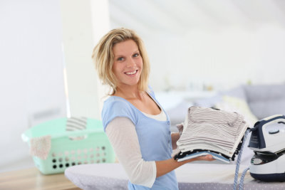 Woman ironing some clothes